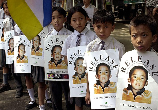 Tibetan schoolchildren in Delhi, India, hold posters calling for the Panchen Lama's freedom in a file photo.