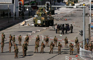 Chinese military patrol the streets in the Tibetan capital Lhasa on March 15, 2008 after violent protests.
