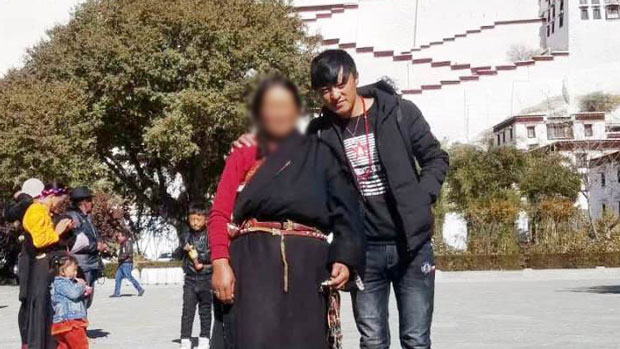 Detained Tibetan protester Wangchen (R) is shown in an undated photo.