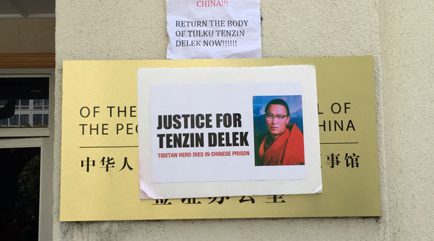 A poster calling on China to return the remains of Tenzin Delek Rinpoche to his family is shown on the Chinese consulate in San Francisco in a July 14, 2015 photo.