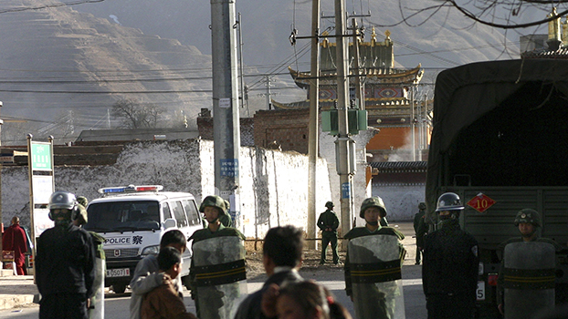 Chinese riot police and military stand guard near Rongwo monastery, in China's Qinghai province, Sunday March 16, 2008.