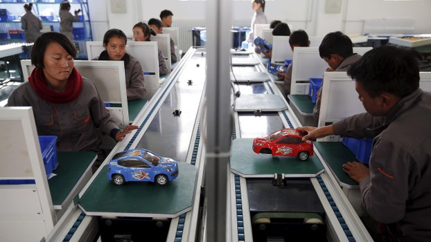 Students work on an improvised car assembly line as a group of foreign reporters visits a vocational school on a government organised tour in Lhasa, Tibet Autonomous Region, China, in a file photo.