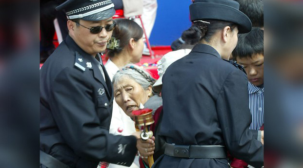 Chinese police block Tibetan worshipers at a religious festival in Lhasa in a file photo.