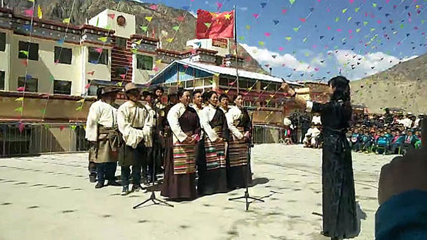 Tibetan villagers in Chamdo sing 'patriotic' songs in a screen grab from a March 29, 2018 video.
