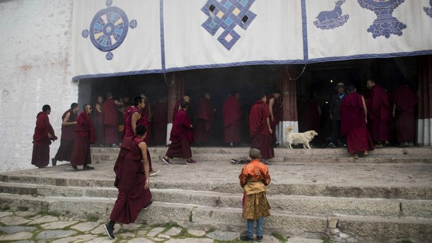 Monks enter the Buddhist Sera monastery in the regional capital Lhasa, in China's Tibet Autonomous Region, in file photo.