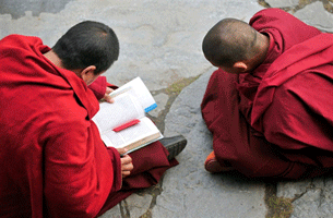 KANGDING, China: Tibetan monks chant prayers at their monastery in the Kardze Tibetan Autonomous Prefecture in China's southwestern Sichuan province, 23 March 2008.