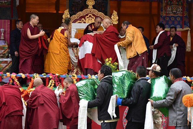 Buddhist followers offer gifts to the Dalai Lama after he delivered religious teachings in Bomdila, in India's Arunachal Pradesh state, April 5, 2017.
