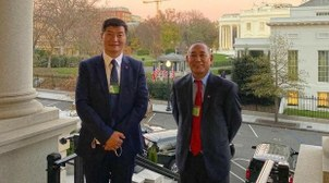 Tibetan exile political leader Lobsang Sangay (L) and aide Ngodup Tsering stand outside the White House compound following a meeting with administration officials, Nov. 20, 2020.