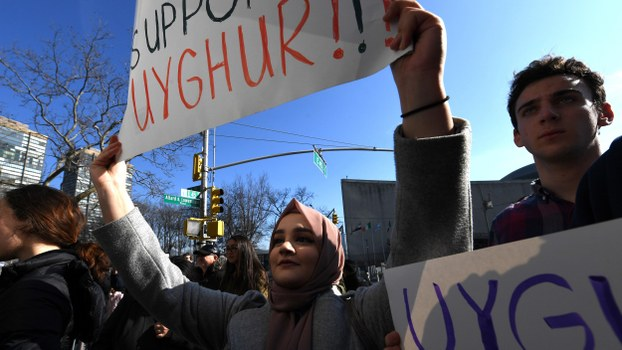 People protest at a Uyghur rally in front of the US Mission to the United Nations in New York, Feb. 5, 2019.