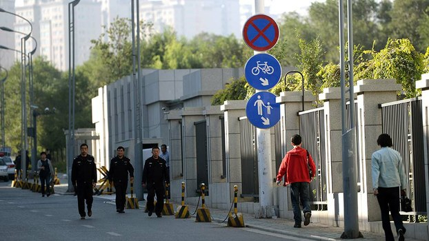 Chinese police leave the Intermediate People's Court in Urumqi, in a file photo.