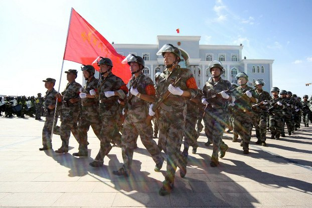 Armed Chinese paramilitary policemen march during an anti-terrorist drill in Xinjiang, July 2, 2013.