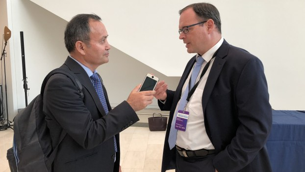 Adrian Zenz (R) speaks with RFA during an interview in Washington, July 17, 2019.
