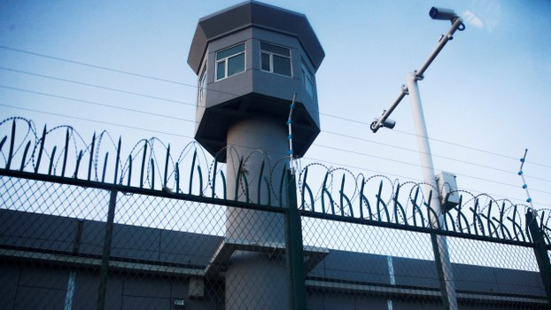 A guard watchtower rises along a perimeter fence of what is officially known as a 'vocational center' in Urumqi's Dabancheng district, in the Xinjiang Uyghur Autonomous Region, Sept. 4, 2018.
