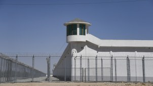 A watchtower overlooks a high-security facility on the outskirts of Hotan, in northwestern China's Xinjiang Uyghur Autonomous Region, May 31, 2019.