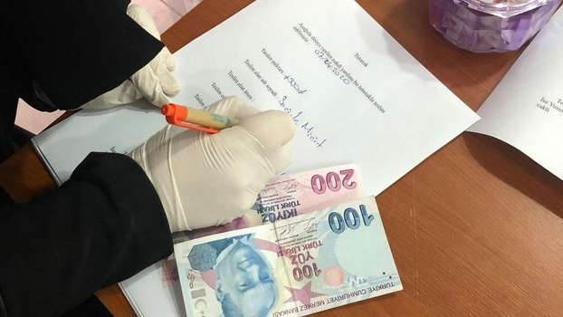 A member of a Turkey-based exile group prepares a coronavirus donation for a Uyghur family in Istanbul, April 2, 2020.