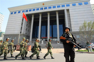 Chinese armed police take position outside a court building in Urumqi, Sept. 12, 2009.