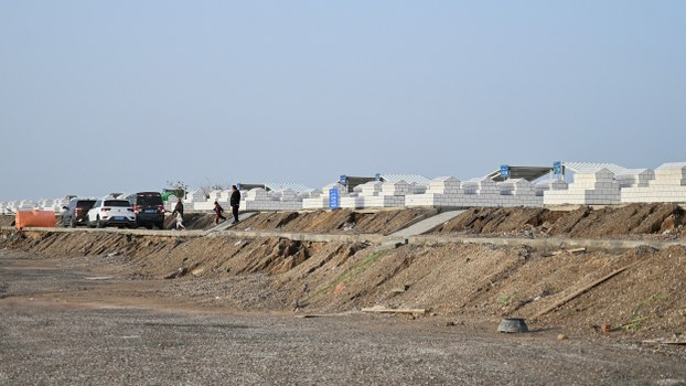 A cemetery on the outskirts of Xinjiang's Aksu city, where bodies from a destroyed Uyghur graveyard were recently moved, Sept. 14, 2019.