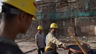 uyghur-kashgar-old-city-workers-june-2019-crop.jpg