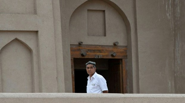 A Uyghur man stands outside a mosque in Turpan, Xinjiang, in a file photo.