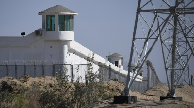 Guard towers are shown on a high-security facility near an internment camp in Xinjiang in a file photo.