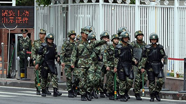 Chinese troops patrol Xinjiang, in file photo,