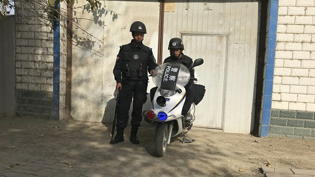 Police officers on duty in the vicinity of a center believed to be used for re-education in Korla city, Xinjiang, Nov. 2, 2017.