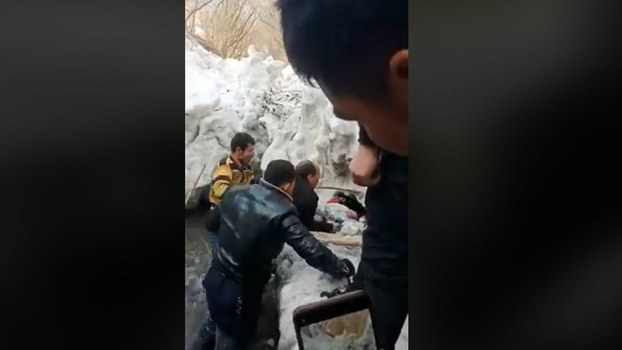 Villagers retrieve the frozen body of of Nesrulla Yusuptohti, a five-year-old Uyghur boy who was left in the care of grandparents because his parents are incarcerated for religious and political reasons, from a ditch in Hotan prefecture of Xinjiang Uyghur Autonomous Region (XUAR), Dec. 15, 2019.