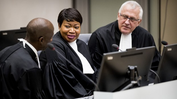 International Criminal Court (ICC) chief prosecutor Fatou Bensouda (C) and deputy prosecutor James Stewart (R) attend an initial appearance before judges at the ICC in The Hague, Jan. 25, 2019.