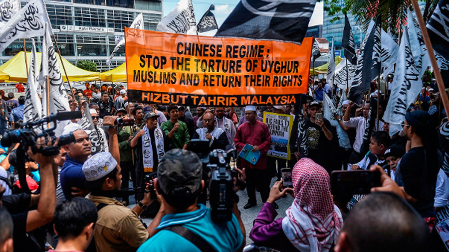 Members of Hizbut Tahrir Malaysia rally outside China's embassy in Kuala Lumpur to condemn the detention of Uyghurs in the Xinjiang region, Dec. 27, 2019.