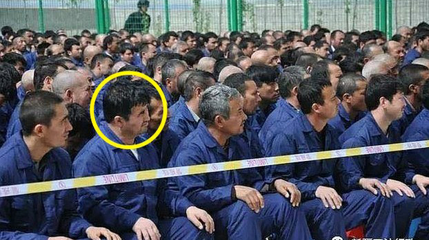 A Uyghur inmate identified as Mettursun Eziz listens to a 'de-radicalization' speech at the Kaifaqu internment camp in Lop county, April 2017.