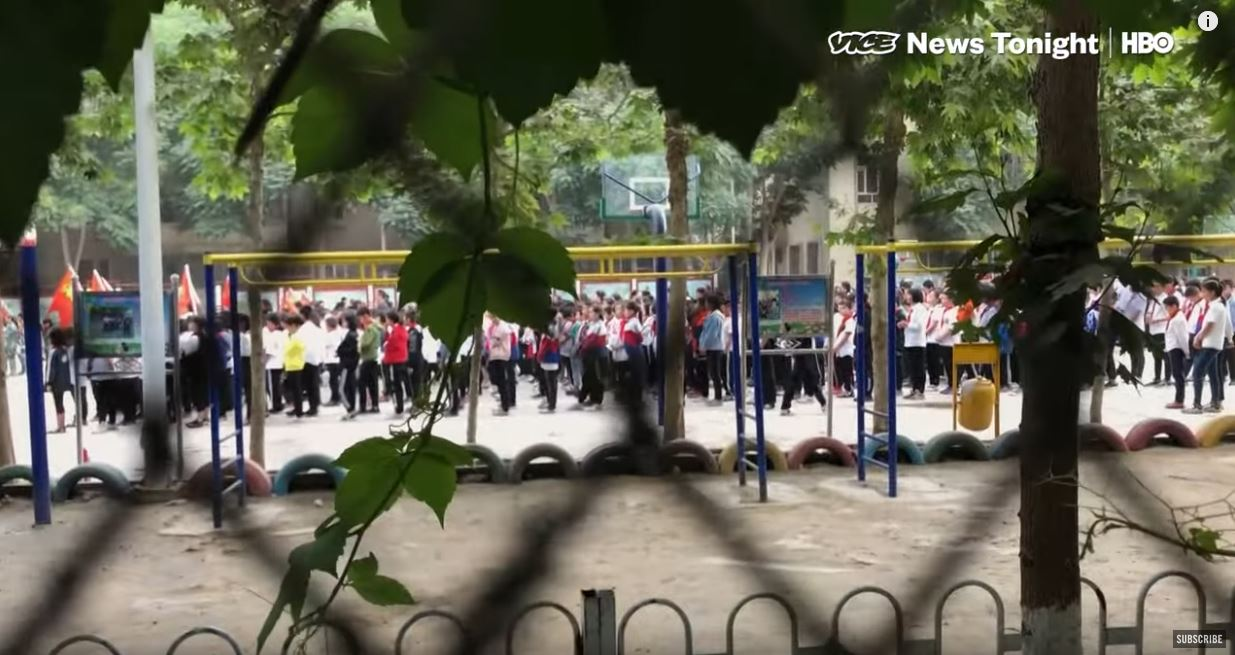 A screen grab from Isobel Yeung's video report shows children reciting propaganda at a 'kindergarten' in Hotan. Credit: Vice News/HBO