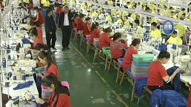 In this file image from undated video footage run by China's CCTV, Muslim trainees work in a garment factory at the Hotan Vocational Education and Training Center in Hotan, Xinjiang.