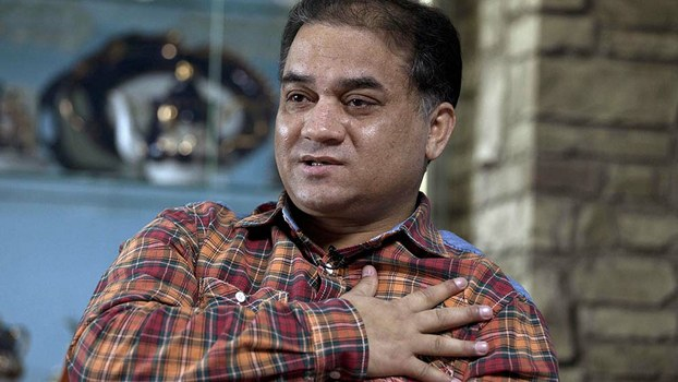 Ilham Tohti speaks during an interview at his home in Beijing, in a file photo.