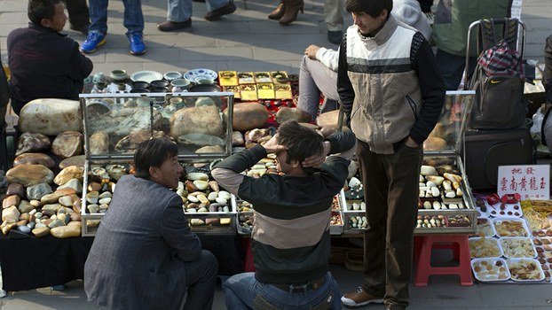 Uyghur jade vendors wait for customers at an outdoor curio market in Beijing, in a file photo.