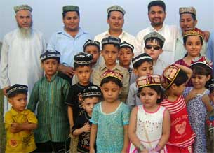 Members of the Omer Uyghur Foundation and language school pose for a photo in Rawalpindi, Pakistan in February 2010.