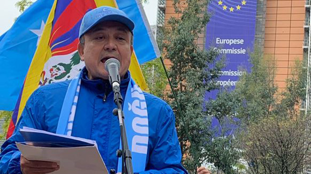 World Uyghur Congress (WUC) President Dolkun Isa speaks during a protest of Beijing's rights record on the 70th anniversary of the founding of the People's Republic of China in Brussels, Belgium, Oct. 1, 2019.