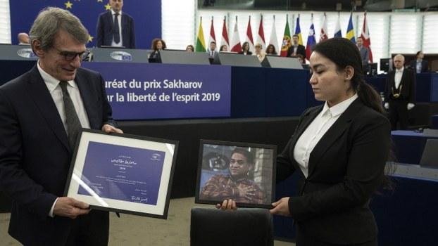Jewher Ilham (R), daughter of jailed Uyghur scholar Ilham Tohti, and European Parliament President David Sassoli (L) attend the Sakharov Prize ceremony at the European Parliament, in Strasbourg, France, Dec. 18, 2019.