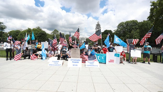 Uyghurs hold a rally in front of the White House in Washington, calling for sanctions on Chinese officials, June 21, 2020.