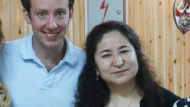Xinjiang University professor Rahile Dawut (L) is shown with Rose-Holman Institute of Technology assistant professor of China studies Timothy Grose in an undated photo.