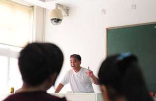 Ilham Tohti lectures in a classroom in Beijing, June 12, 2010.