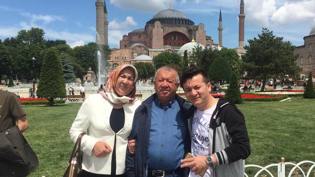 Zahirshah Ablimit (R) and his parents pose in front of the Hagia Sophia in Istanbul, Turkey, in an undated photo.