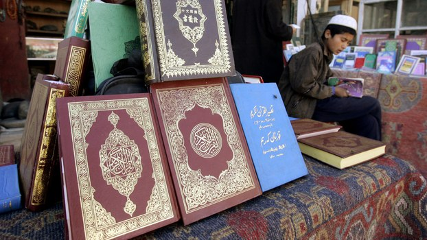 An ethnic minority Muslim man sells copies of the Quran outside of Id kah Mosque in the XUAR's Kashgar city, in a file photo.
