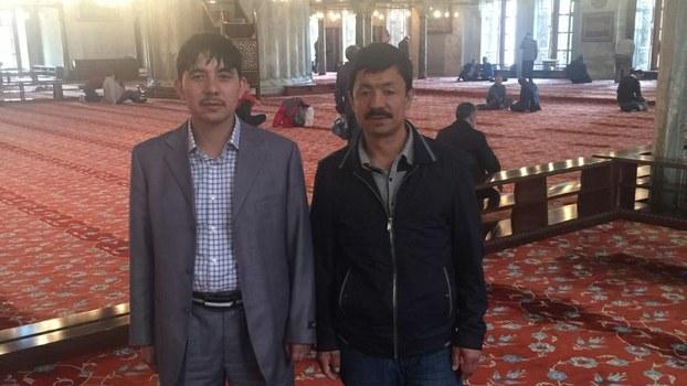 Ibrahim Kurban (L) with friend Abdurehim Rozi (R) in Kashgar, in 2016.
