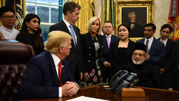 US President Donald Trump meets with survivors of religious persecution in the Oval Office of the White House in Washington, July 17, 2019.