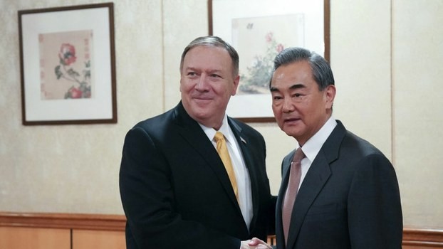 US Secretary of State Mike Pompeo (L) greets Chinese Foreign Minister Wang Yi at the Chinese Mission to the United Nations in New York, Sept. 26, 2019.