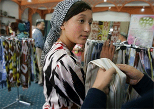 Scarves are sold at a silk factory in Hotan, in China's far west Xinjiang Uyghur Autonomous Region in a file photo.