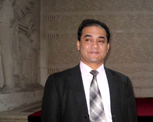 Ilham Tohti in France, February 2009.