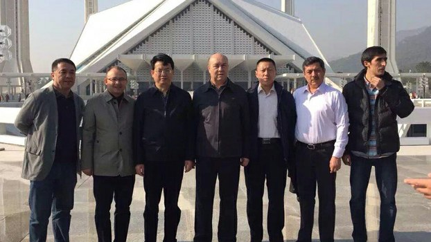 Abdujelil Hajim (second from right) stands with fellow officials from the Kashgar Prefectural Trade Association, in a file photo.