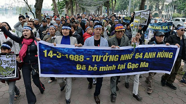 Vietnamese demonstrators chant anti-China slogans during a rally in Hanoi marking the anniversary of a 1988 battle between Vietnam and China in the Spratly Islands, March 14, 2016.
