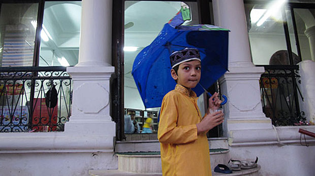 A young Muslim boy stands outside Hanoi's only mosque in a file photo.